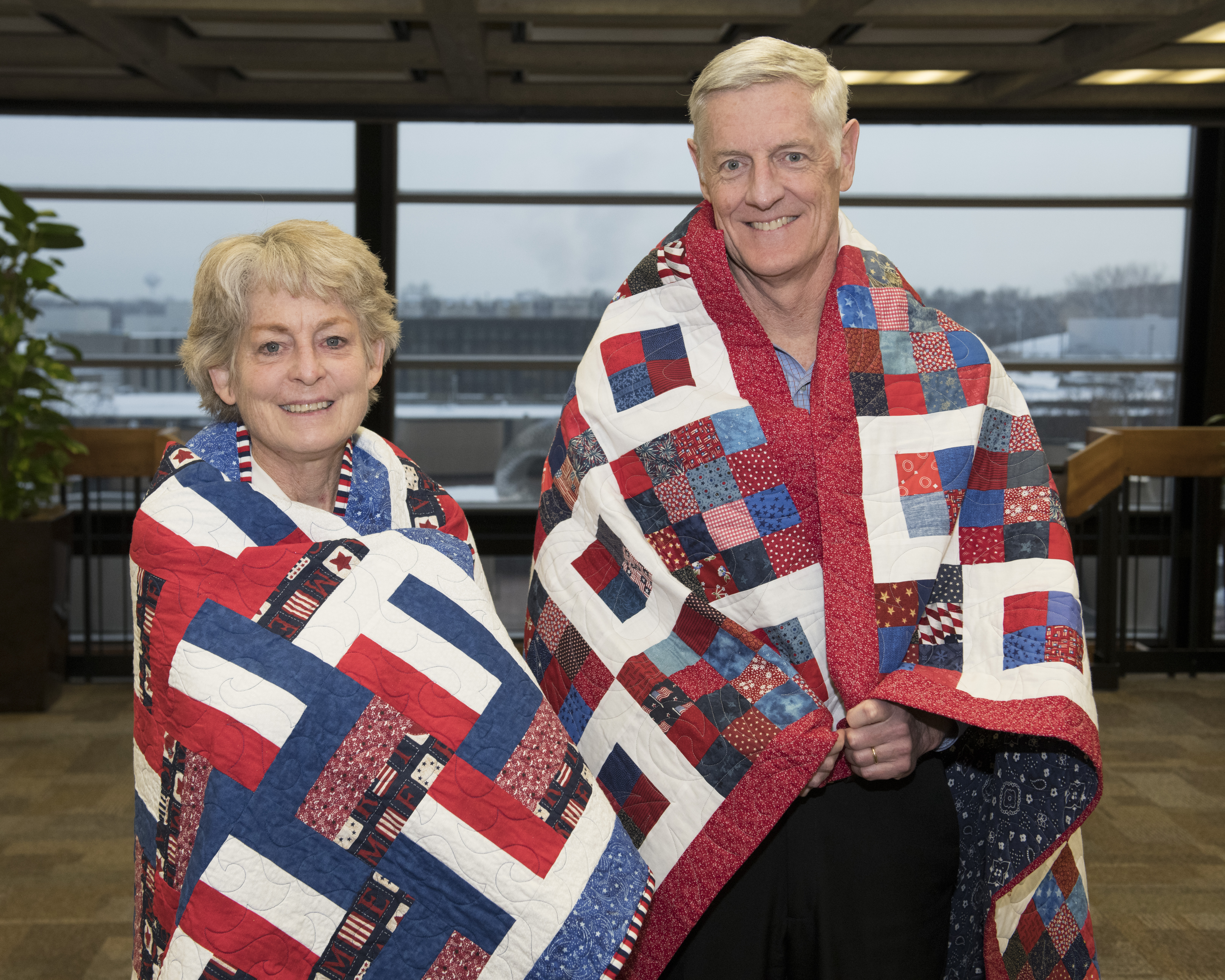 Chris Mossey and Kate Gregory receiving Quilts of Valor on November 29, 2018